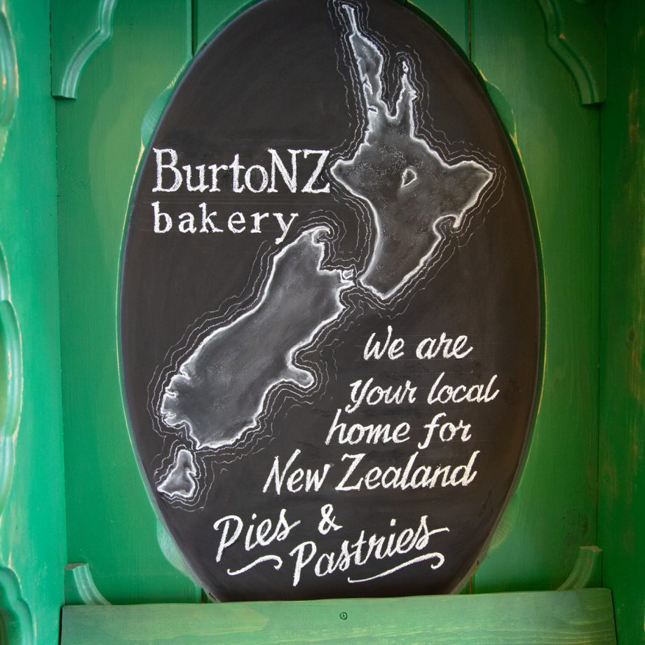 A green board with welcome text to BurtoNZ Bakery